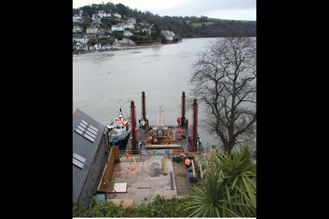 A temporary platform was erected over the estuary to receive building materials transported by barge.